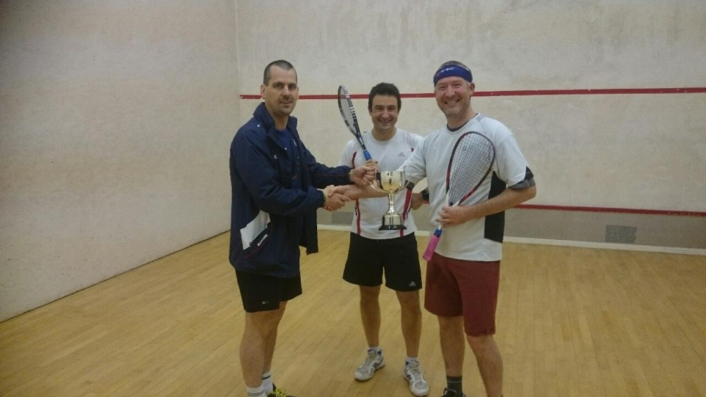Del Sharratt (Left) presents Andy Gil lwith the Trophy, Luis Molero looks on wistfully