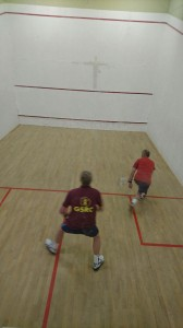 Hugh McClelland keeping John Barrow at the back of the court