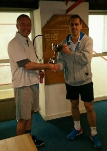Andy presented with the trophy by club captain Del